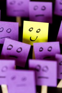 43607229 - hand drawn faces on sticky notes with on that stands out in a positive way